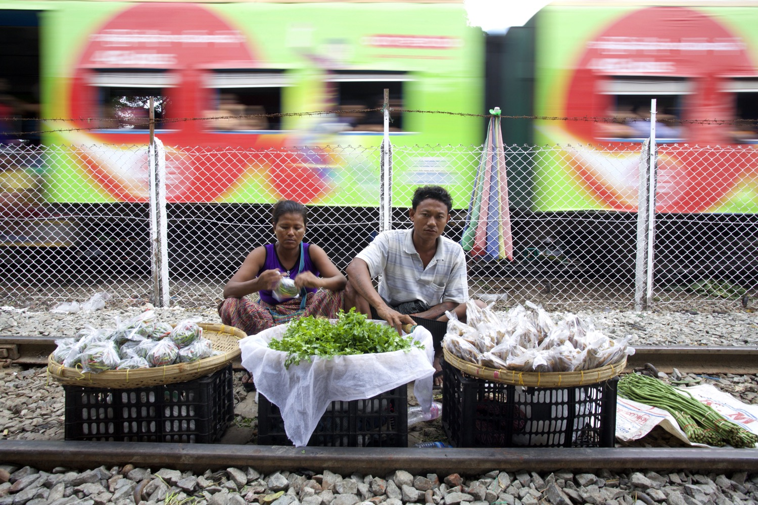street market photography - vendors selling goods on train tracks