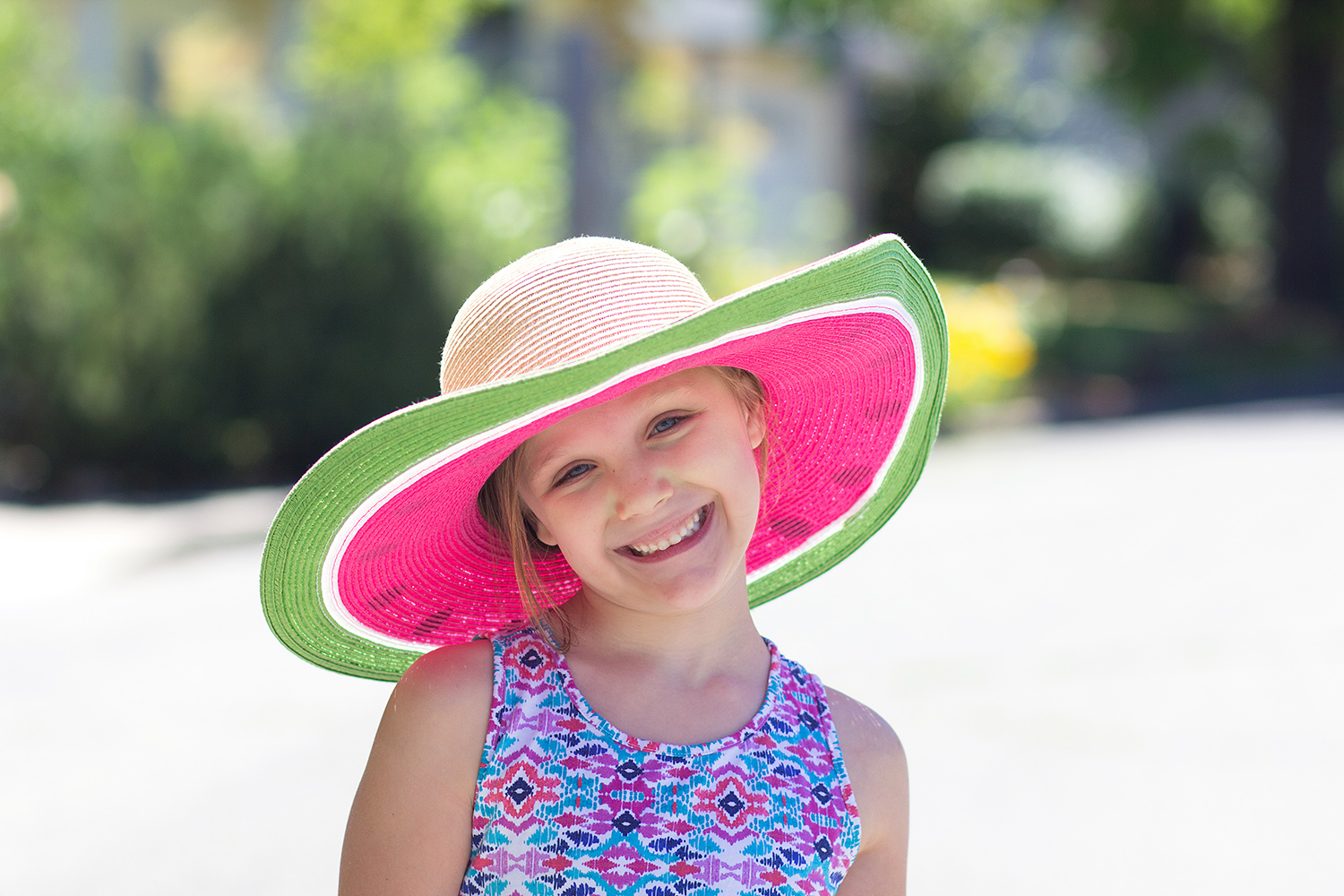 girl in a watermelon hat - 3 Tips For Photographing Kids in Harsh Light