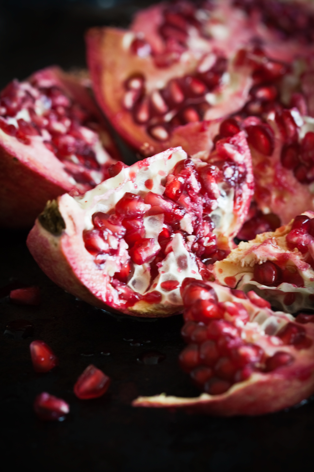 Long exposures can be used for still life indoors pomegranate - Tips for Better Results When Shooting in Low Light Conditions