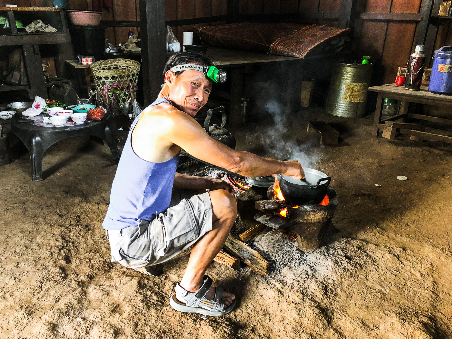 man cooking over a fire - Documentary Photos