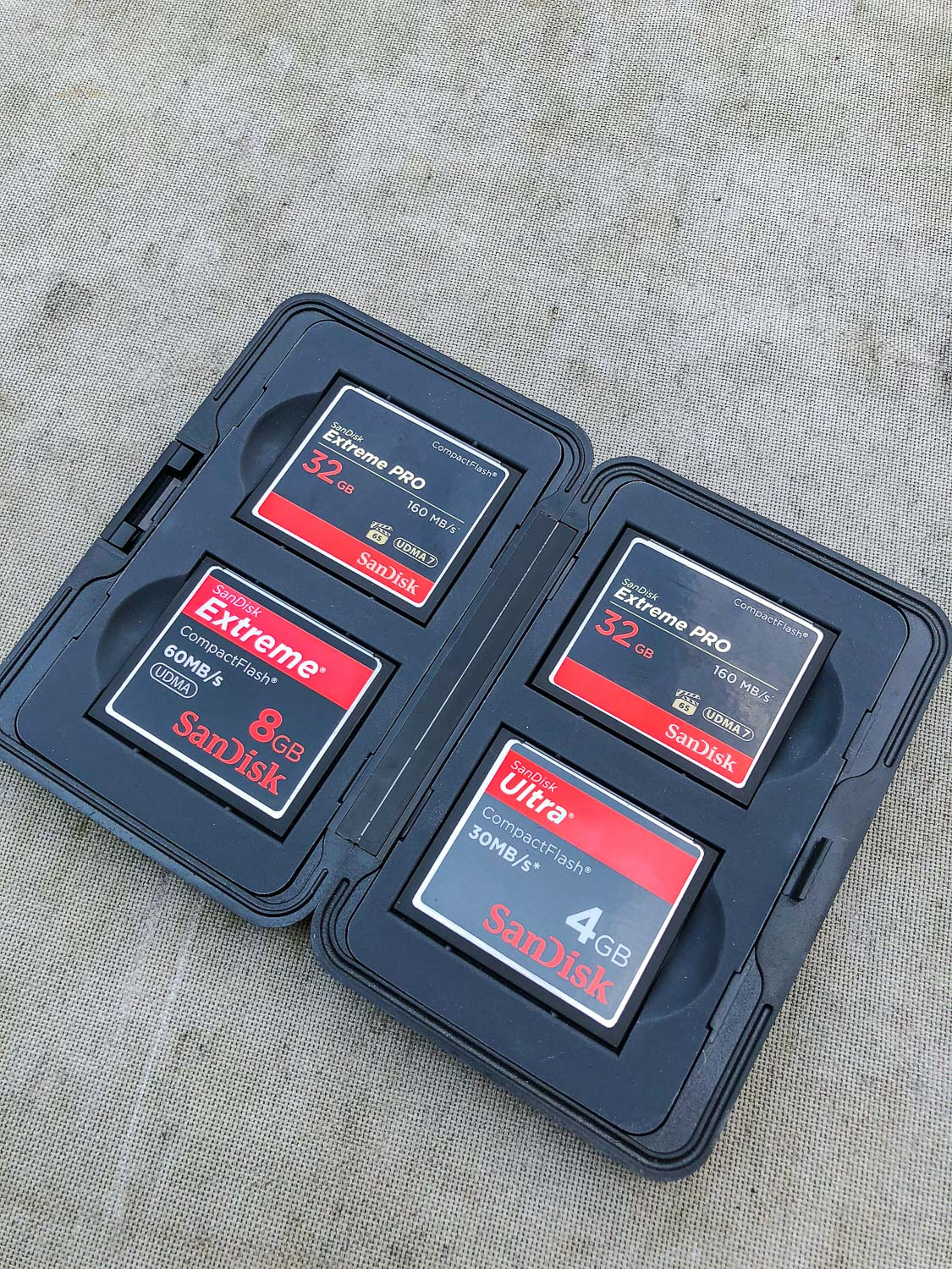 CF memory cards in a case - The First 10 Things You Need to Buy After Your Camera for Travel Photography