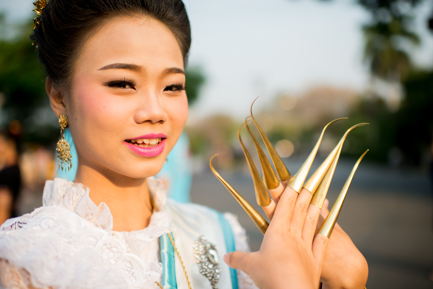 Dancer at a parade in Thailand by Kevin Landwer-Johan (copyright) 7 Tips for Avoiding a Distracting Background in Street Photography