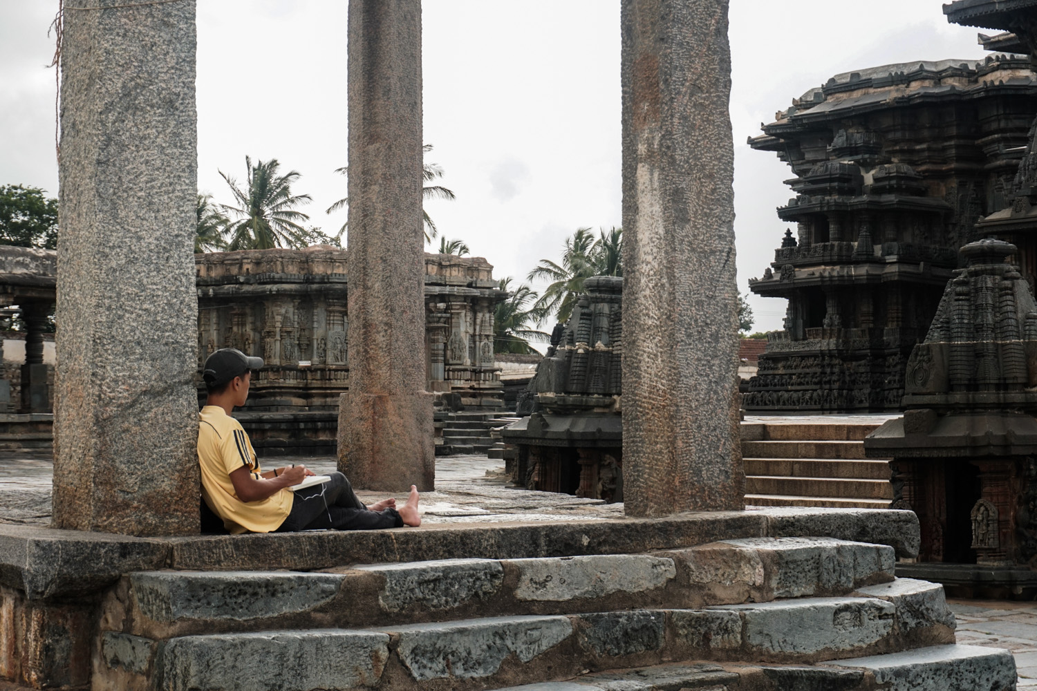 Six Non-Photography Tips to Super-Charge Your Travel Photography - man sitting under columns