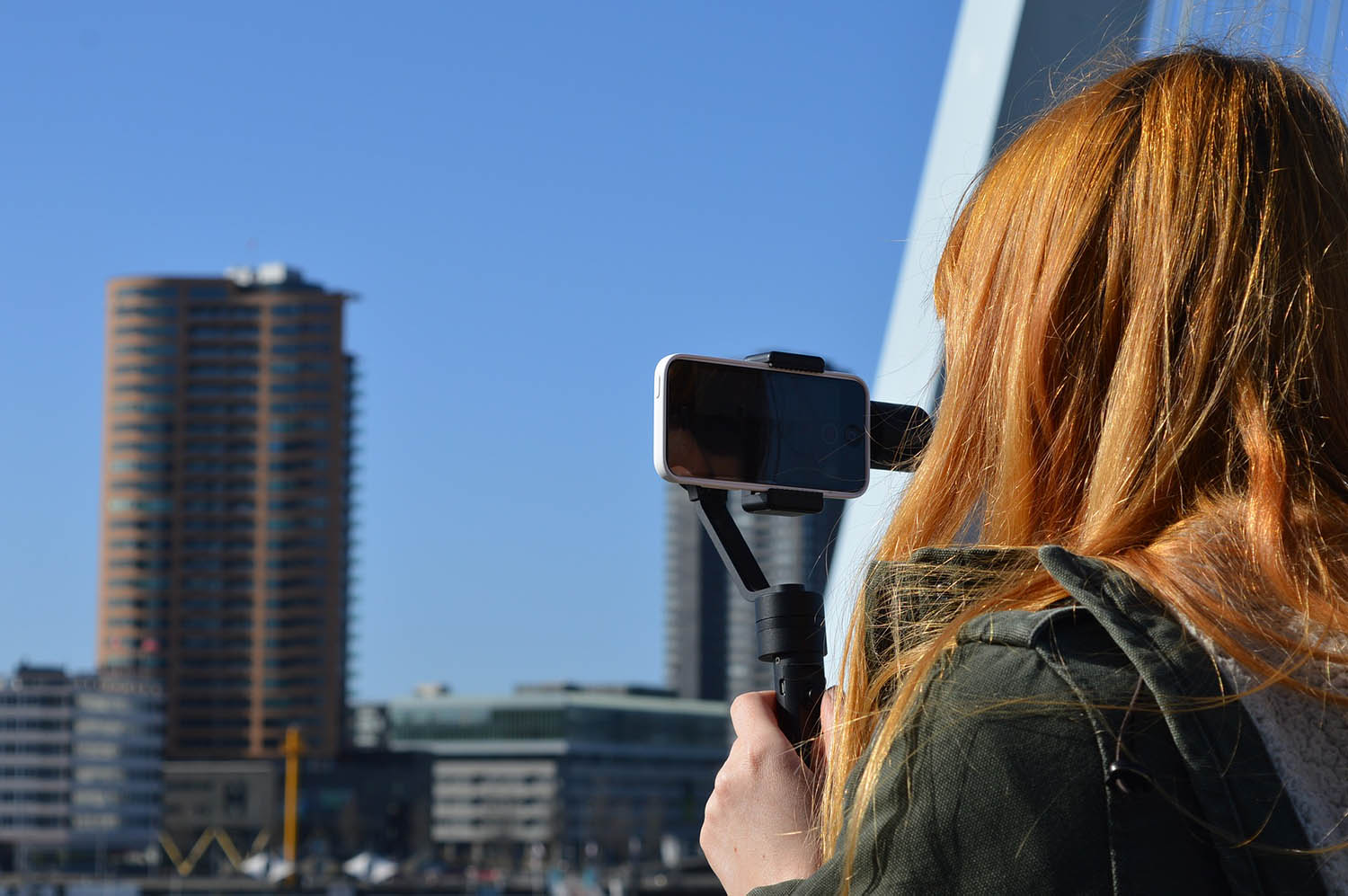 girl using a gimbal smartphone stabilizer