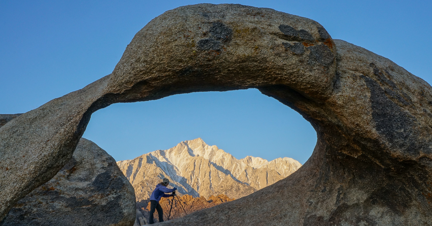 10 Dos and Don'ts for Mastering Your Tripod - photographer under a rock arch