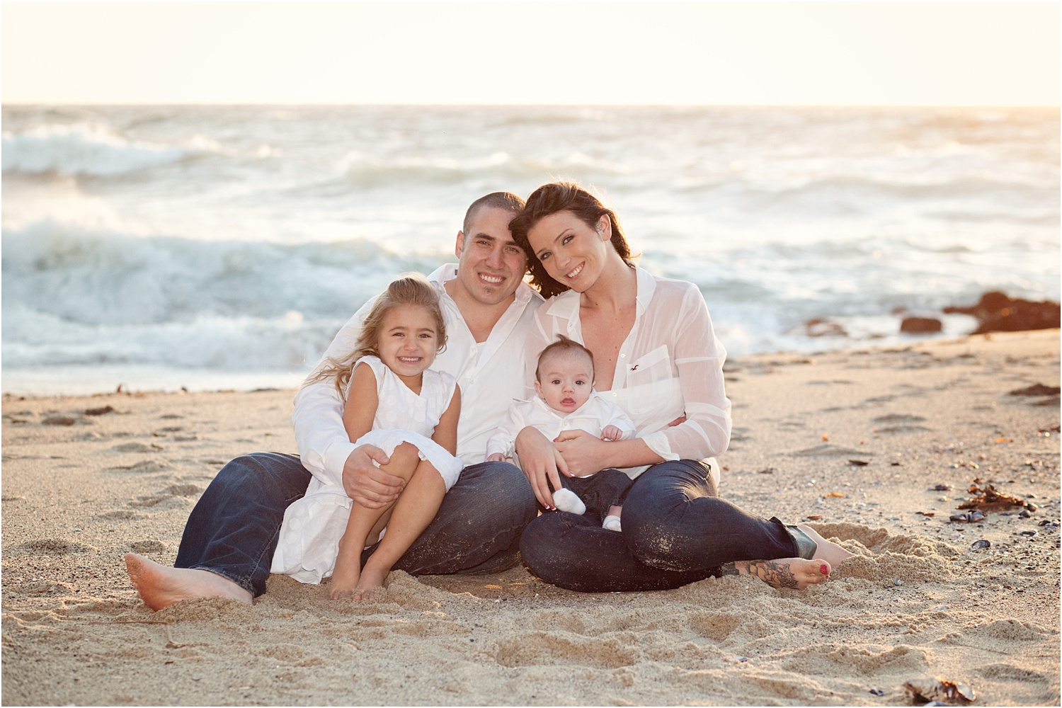 family in white on the beach - Using Flash for Beach Portraits