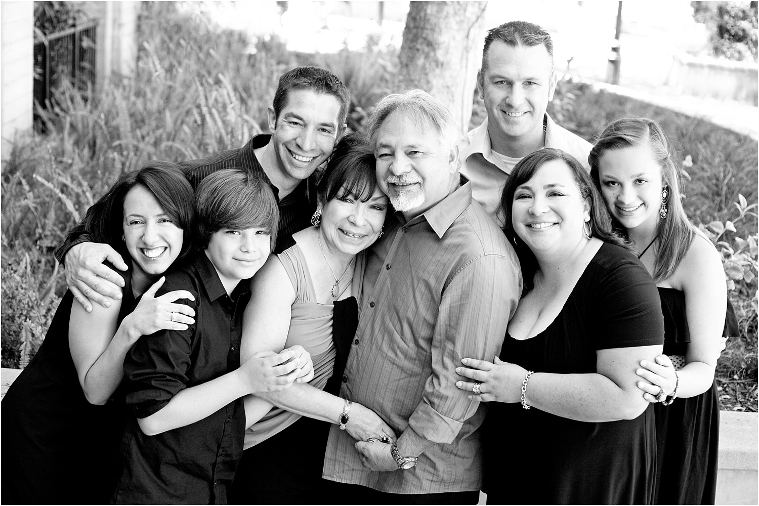 Tips for Posing Large Families and Groups - family hugging b/w