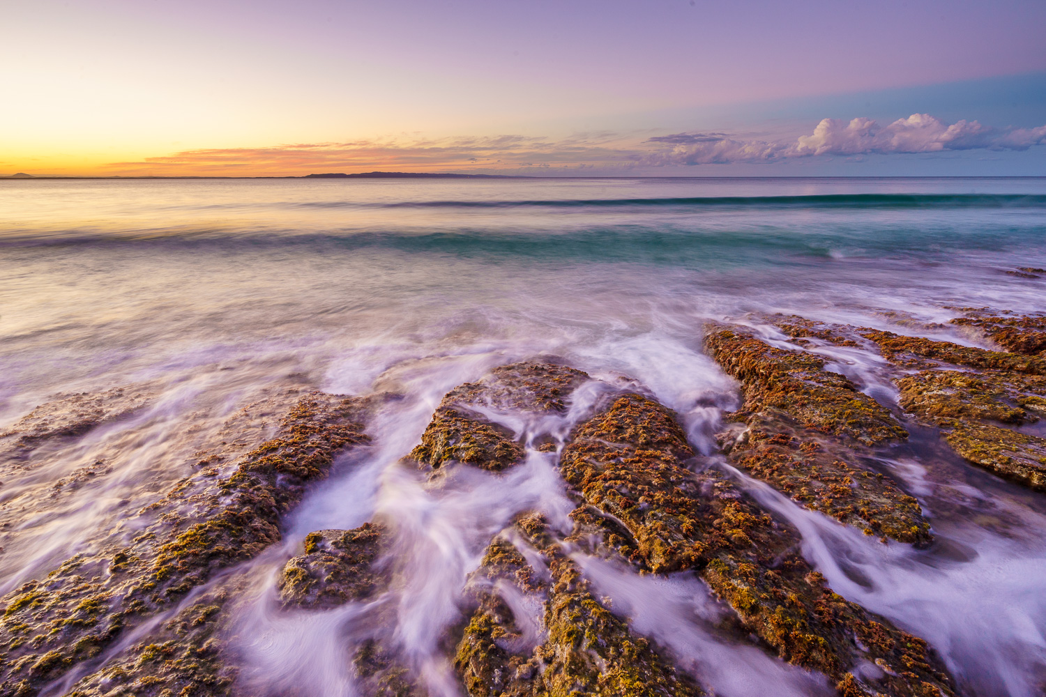 How to Work the Scene to Get More Great Photos - long exposure of ocean waves sunset