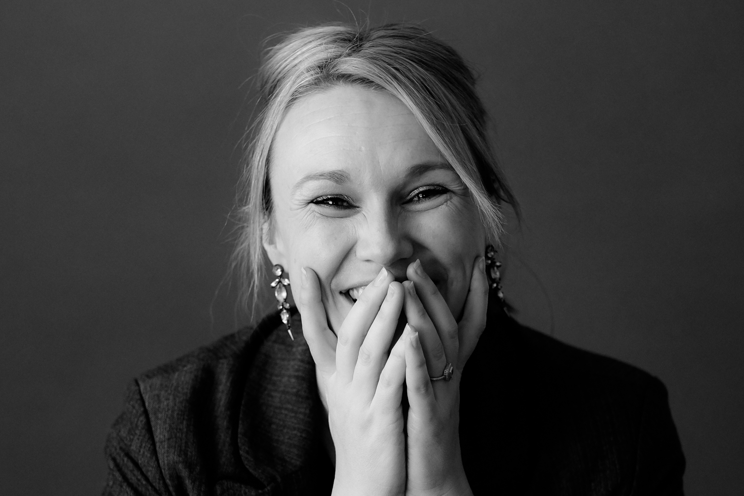 Female headshot laughing - 4 Tips for Helping People Feel Comfortable During Their Portrait Session