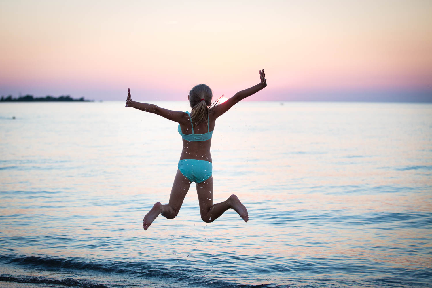 Tips for Preparing for a Portrait Session - girl jumping into the water