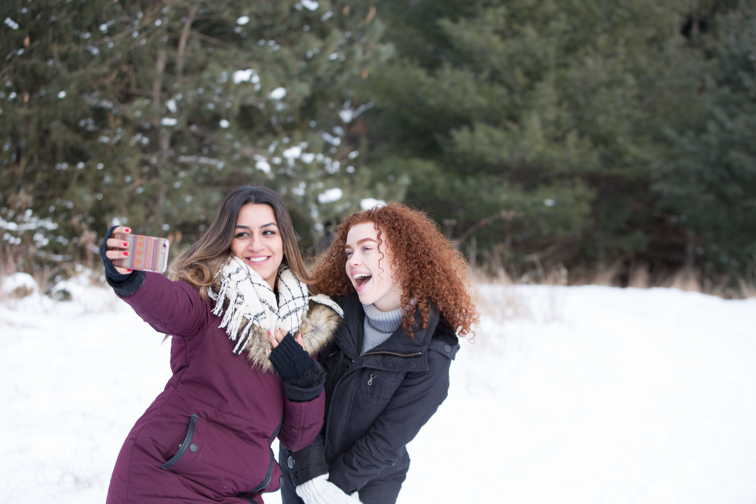 girls in the snow doing a selfie - Tips for Preparing for a Portraits Session