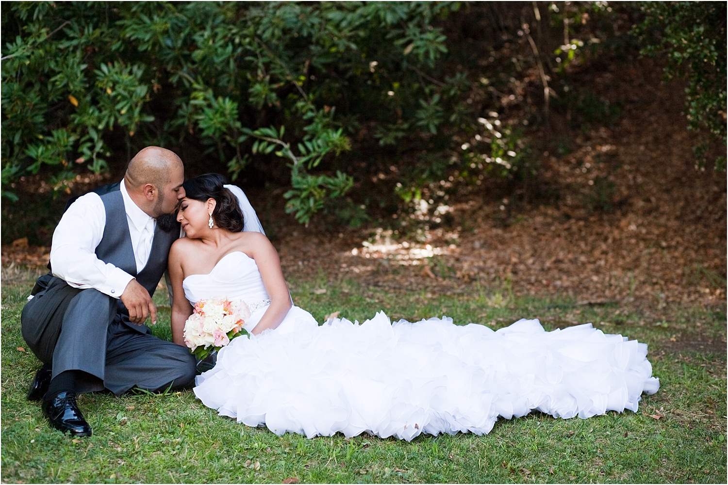 wedding couple in the grass - wedding day photography