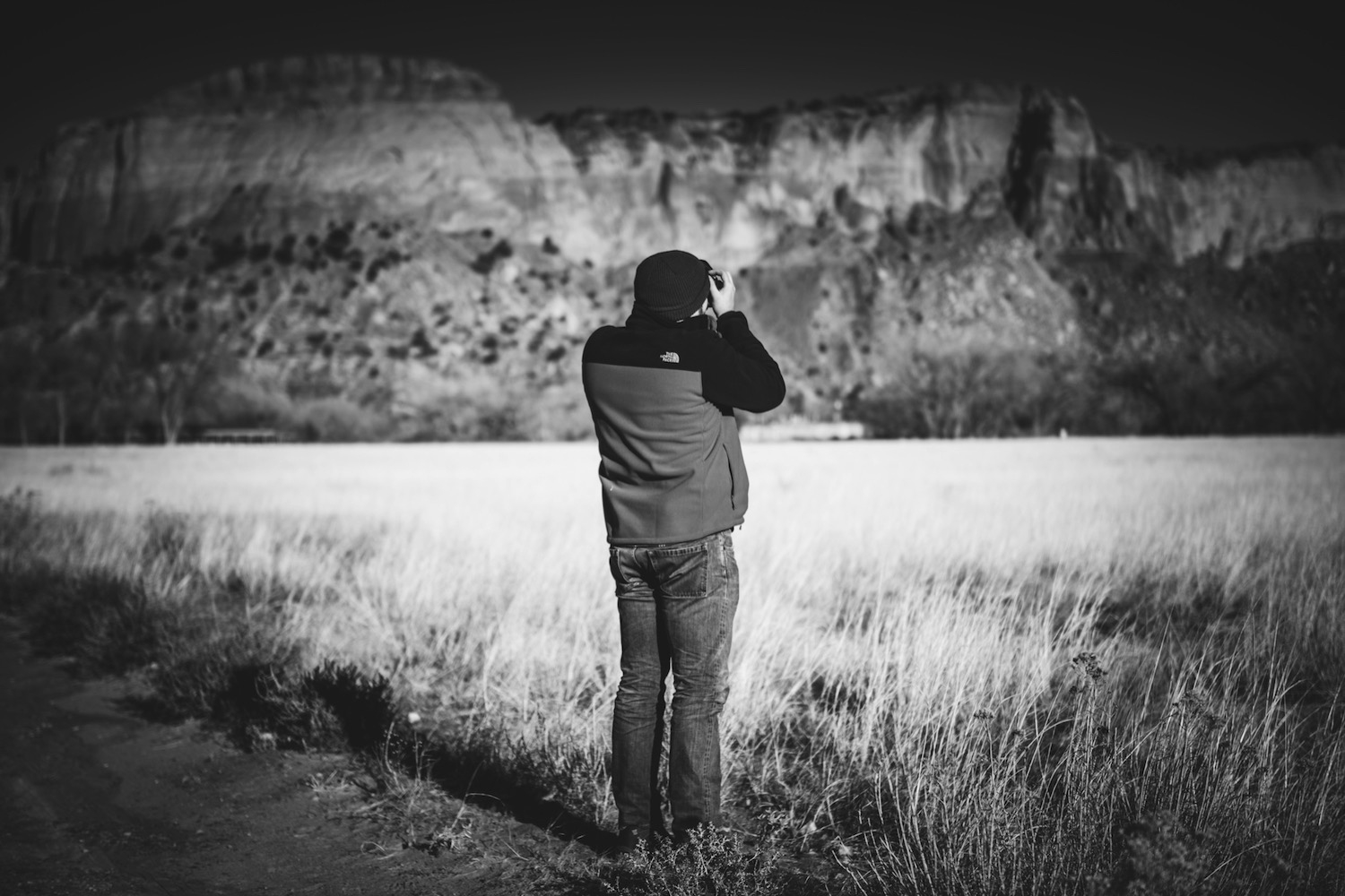 Road trip photography tips - b/w person taking a photo