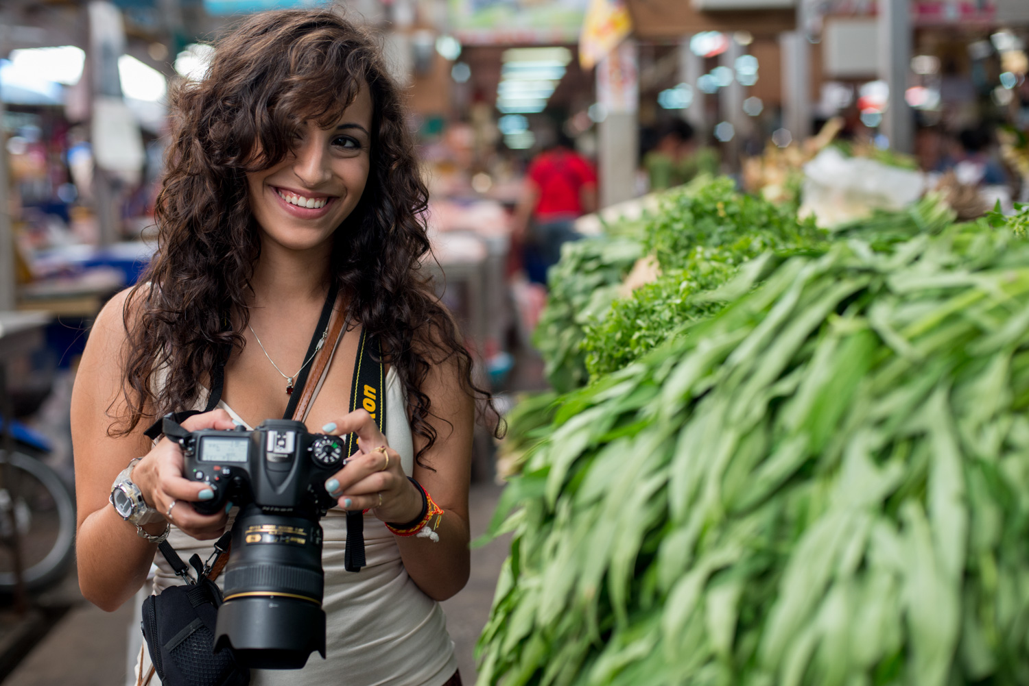 Why Carrying Less Camera Gear Will Make You a Better Photographer Female Photographer