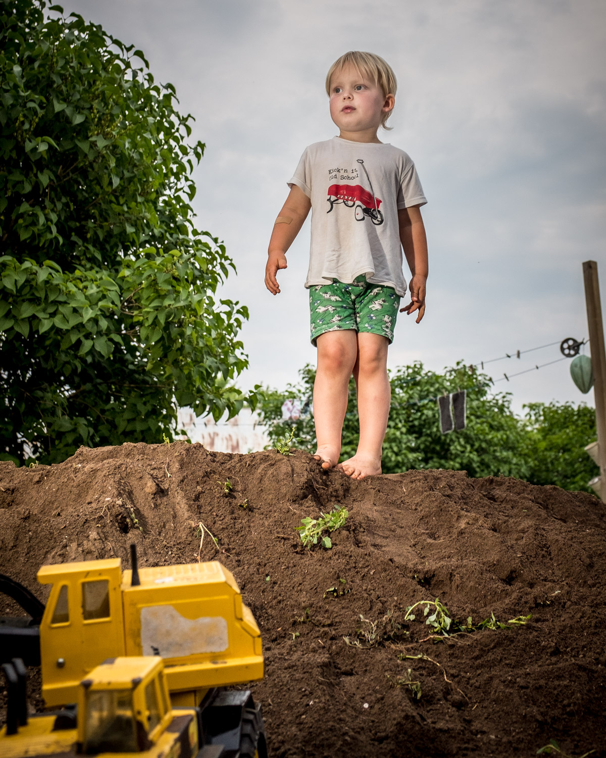 Image: Moment: posedComposition: low angleLight: soft, side lightClimbing a mound of dirt with your...