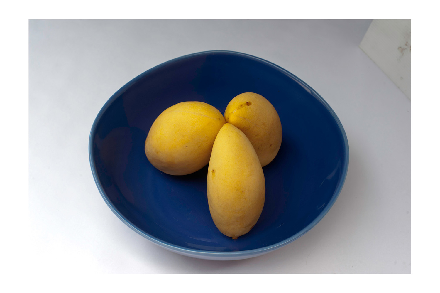 Seven Steps for Post Processing a Pure White Background Three Mangoes in a Bowl