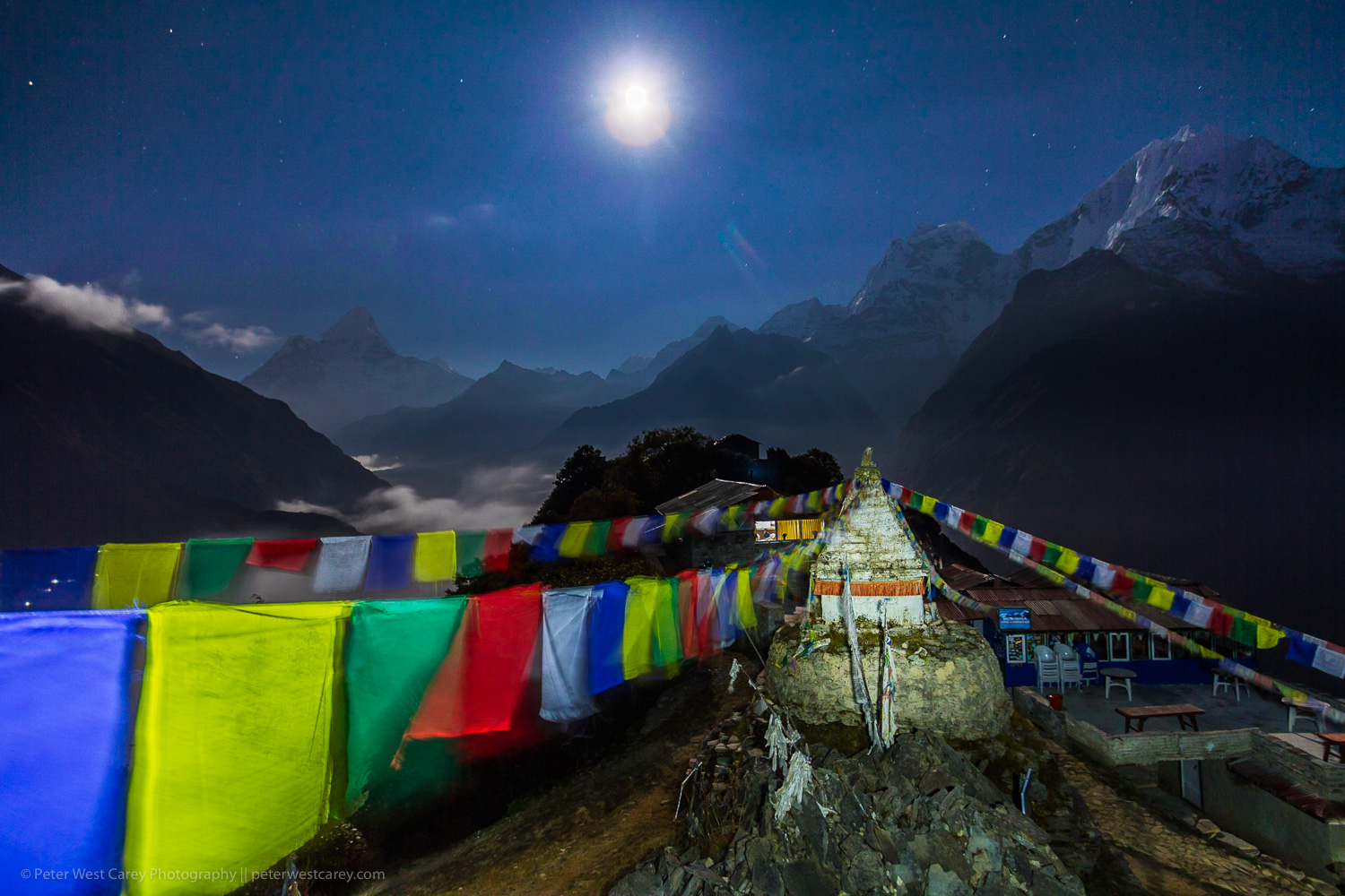 Image: Full moon and chorten with the Himalayas in the background. Mong La, Nepal