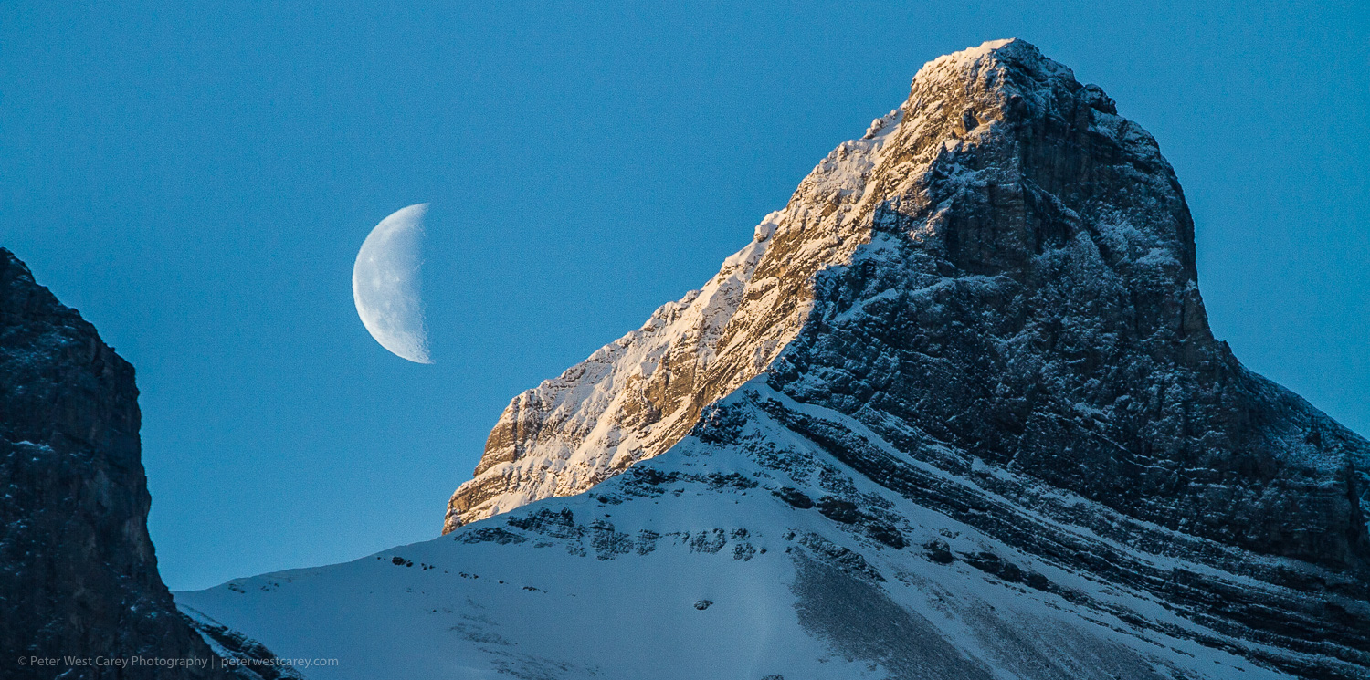 Image: Half moon and the Canadian Rockies