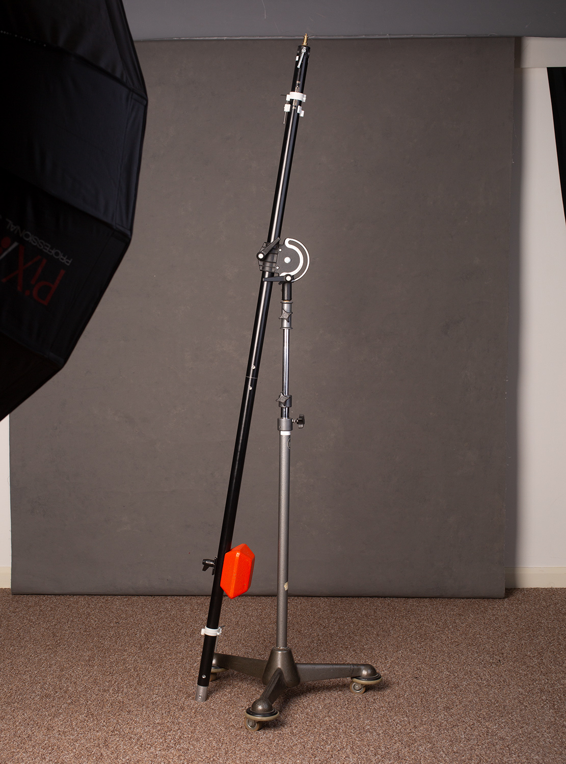 Image: This image shows a boom arm attached to a lighting stand on a dolly. It's a fantastic a...