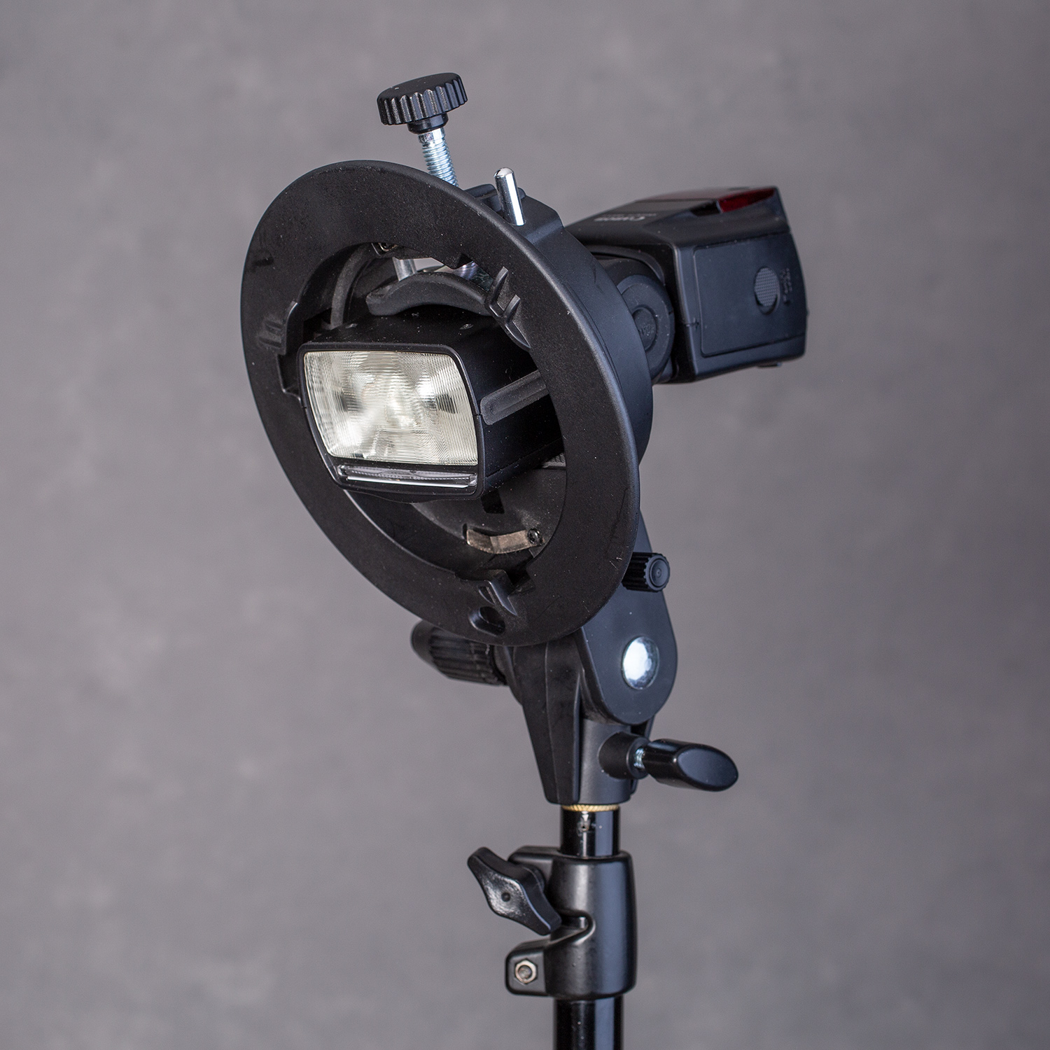 speedlight mounted to a flash stand