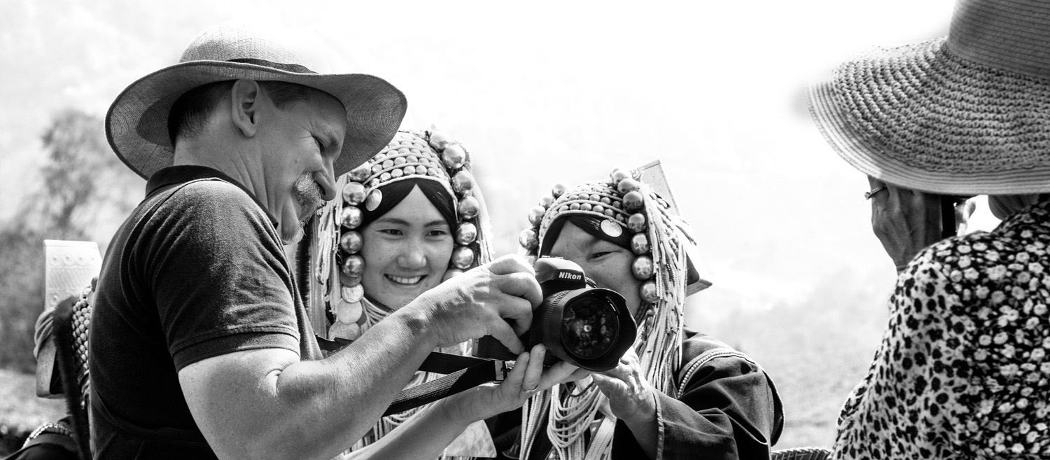 Kevin Landwer-Johan Showing Akha people their photos DPS Ultimate Guide to Photographing People for Shy Photographers