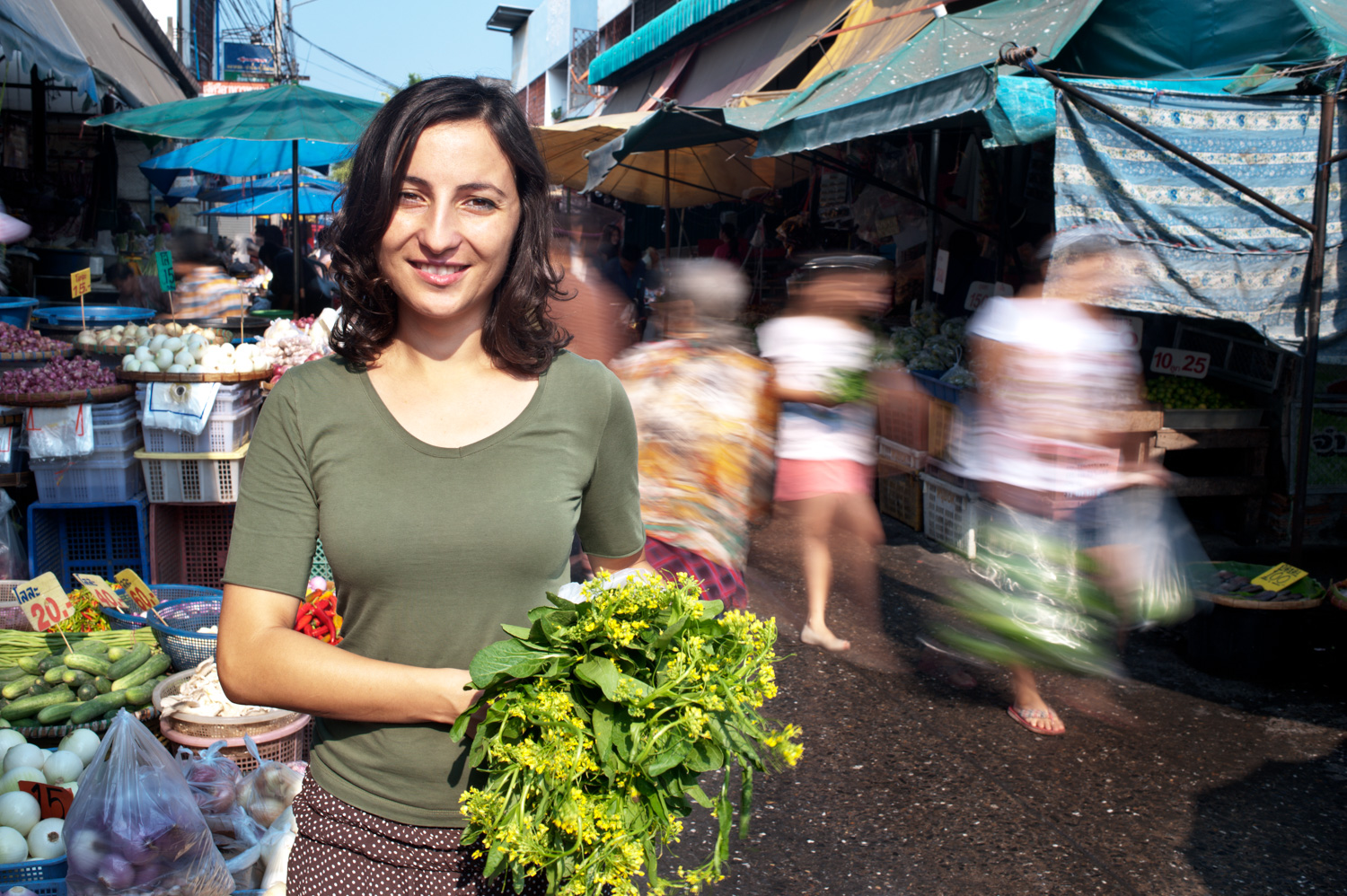Woman at the market with motion blur behind her DPS Ultimate Guide to Photographing People for Shy Photographers