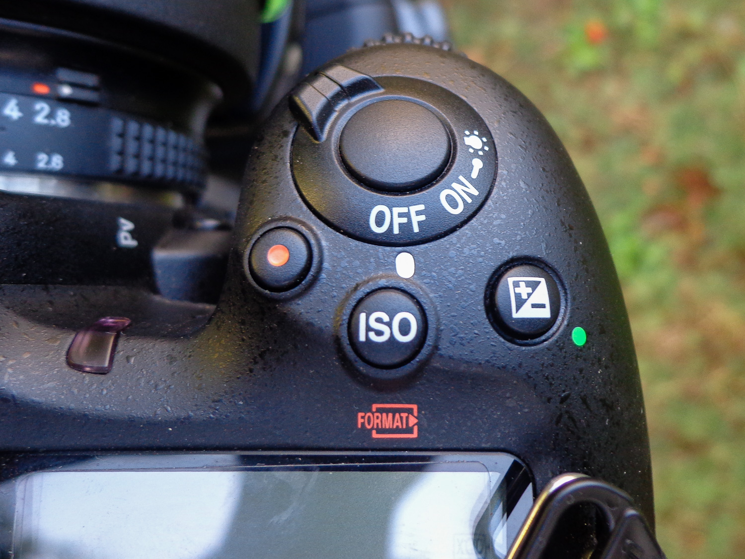 Image: Buttons for Exposure compensation, ISO selection, and movie recording.