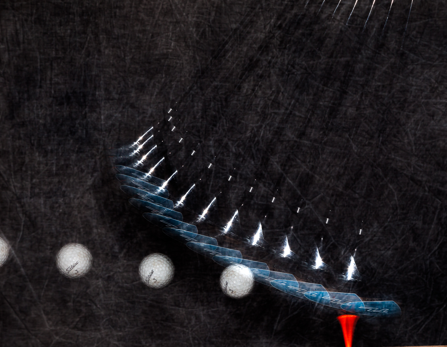 Image: A patterned background too close to the subject and a golf club with a black shaft and head m...