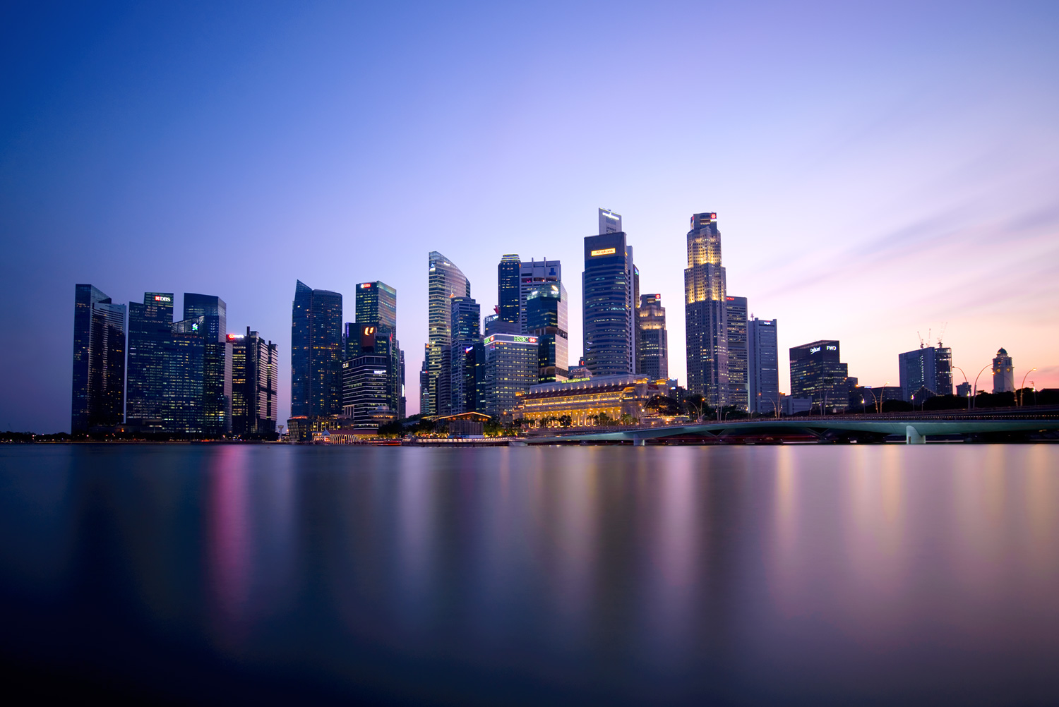 Image: Singapore skyline (18mm, f/5.6, 409 seconds, ISO100). The sun went down on the right edge of...