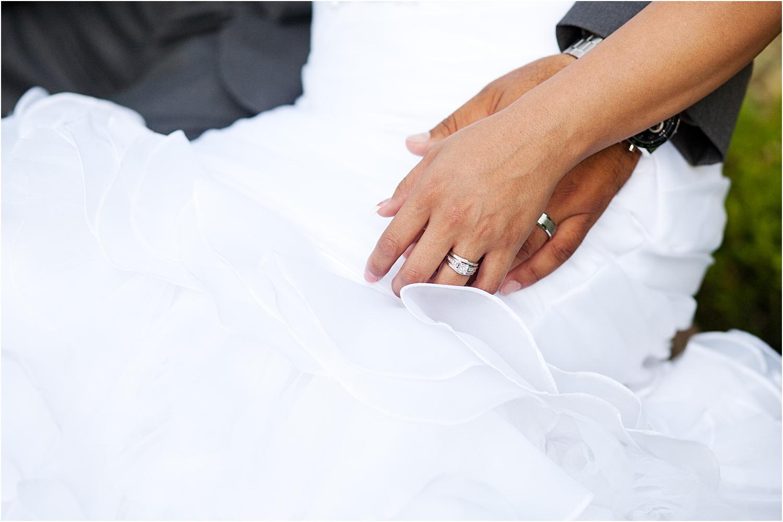 hands near a wedding dress