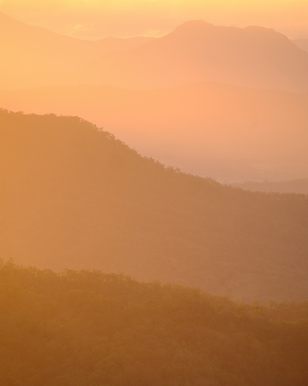 Image: I love how telephoto lenses make faraway objects look close together. Mountain ranges on the...