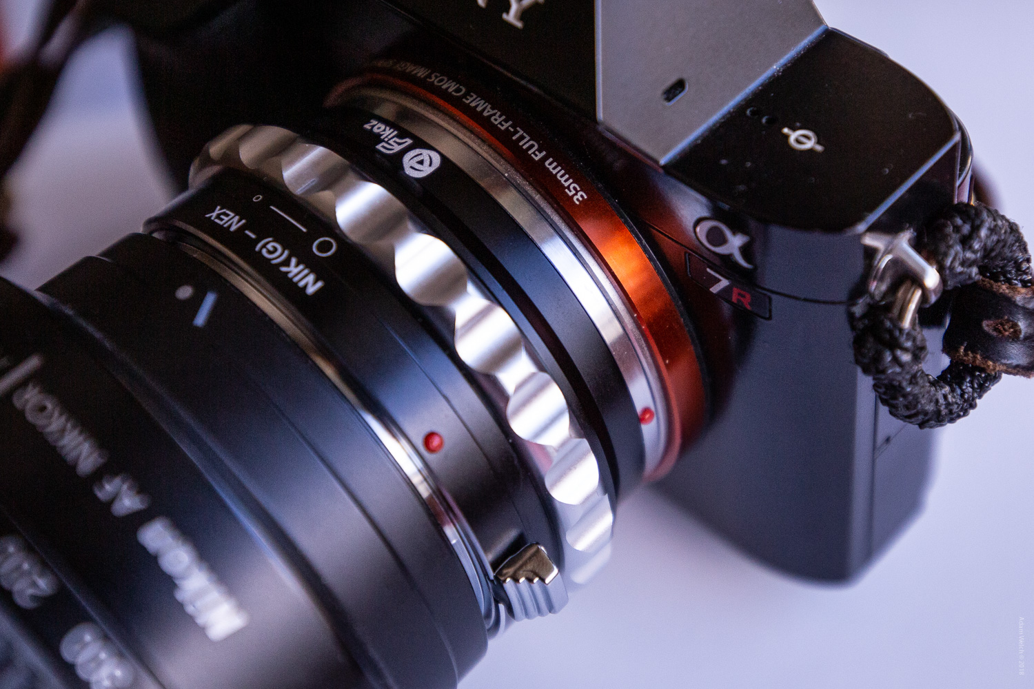 An old Nikon G-mount lens mounted using an adapter to a Sony A7R