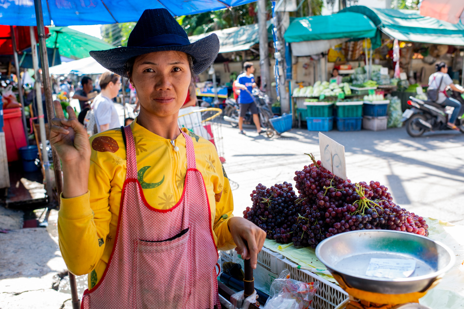 Fruit vendor at a market in Chiang Mai, Thailand