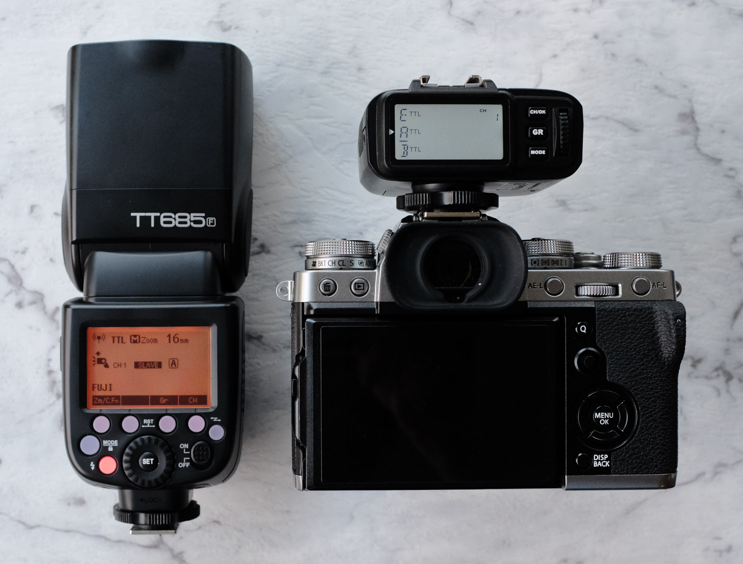 Image: The Godox TT685 in slave mode shown with my Fujifilm X-T3 with the XT1-F wireless trigger att...