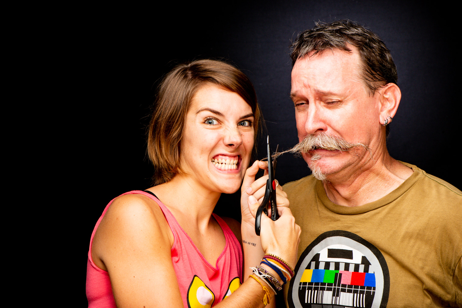 Woman cutting a man's moustache making someone comfortable