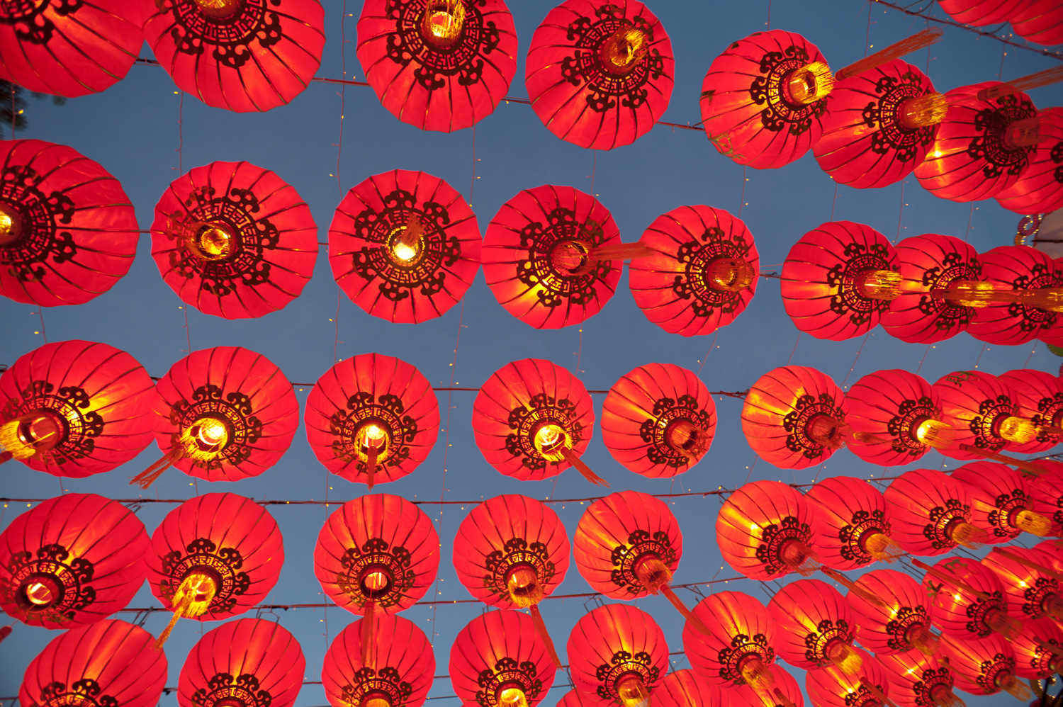 red lanterns against a blue sky