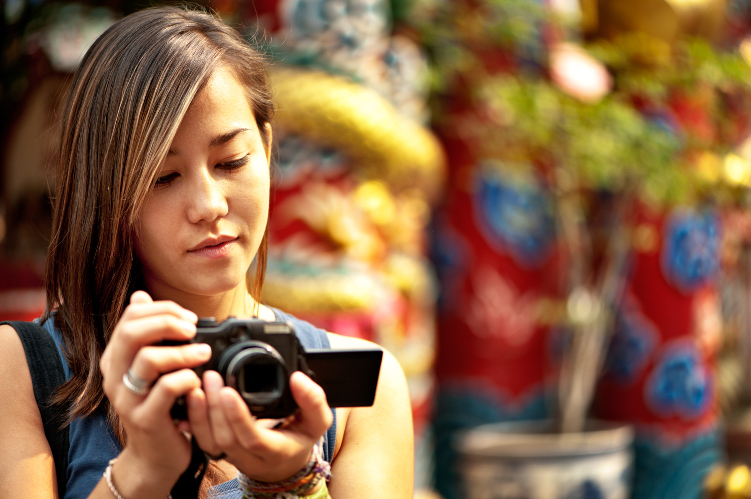 Focusing Tips for Beginners Asian photogrpaher and her camera