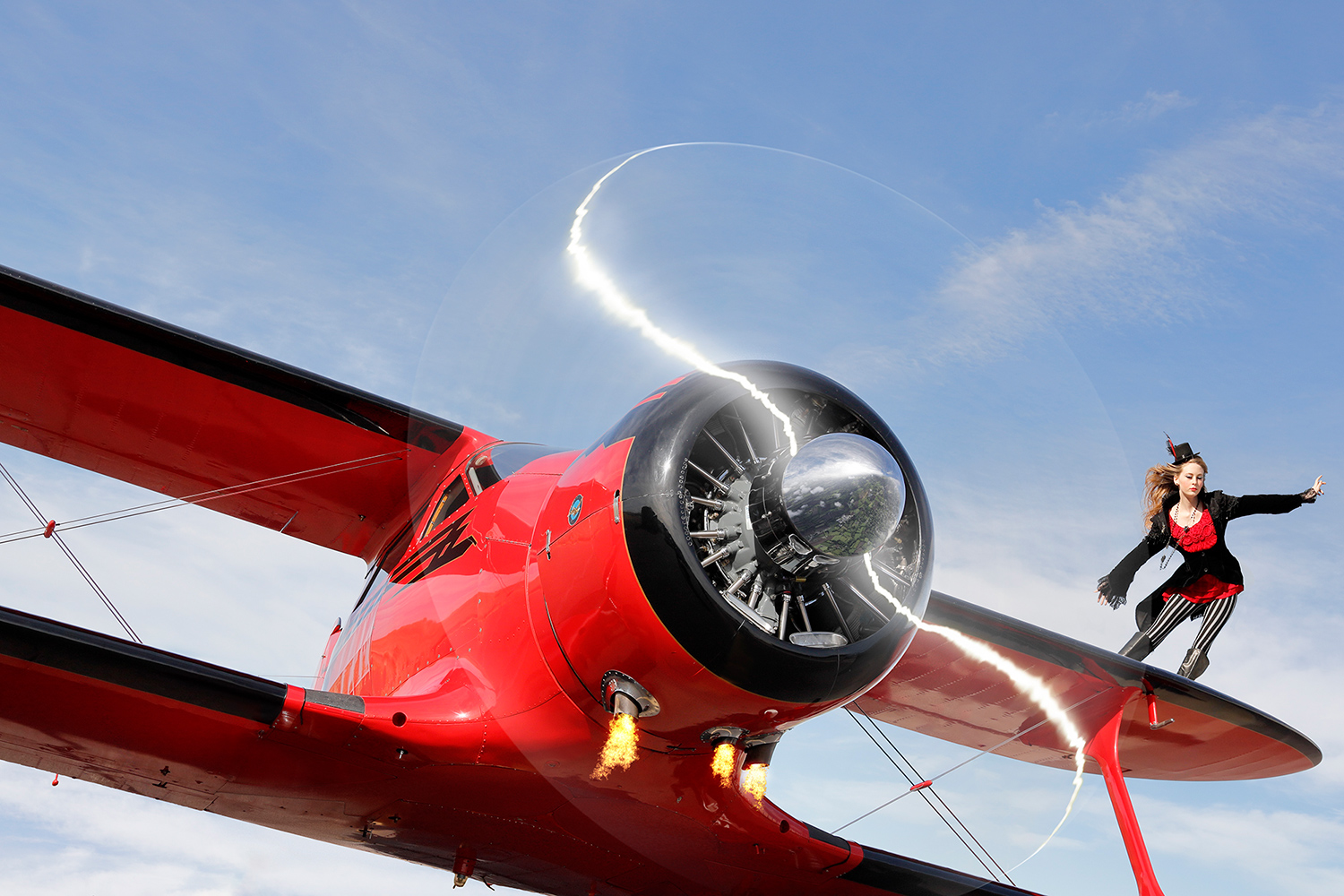 Canon Explorers of Light Series Q&A with photographer Bruce Dorn – Image of a woman on the edge of a red plane wing