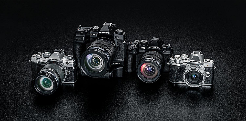 Several Olympus mirrorless cameras.