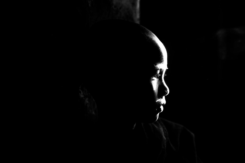 Novice Buddhist monk in the dark