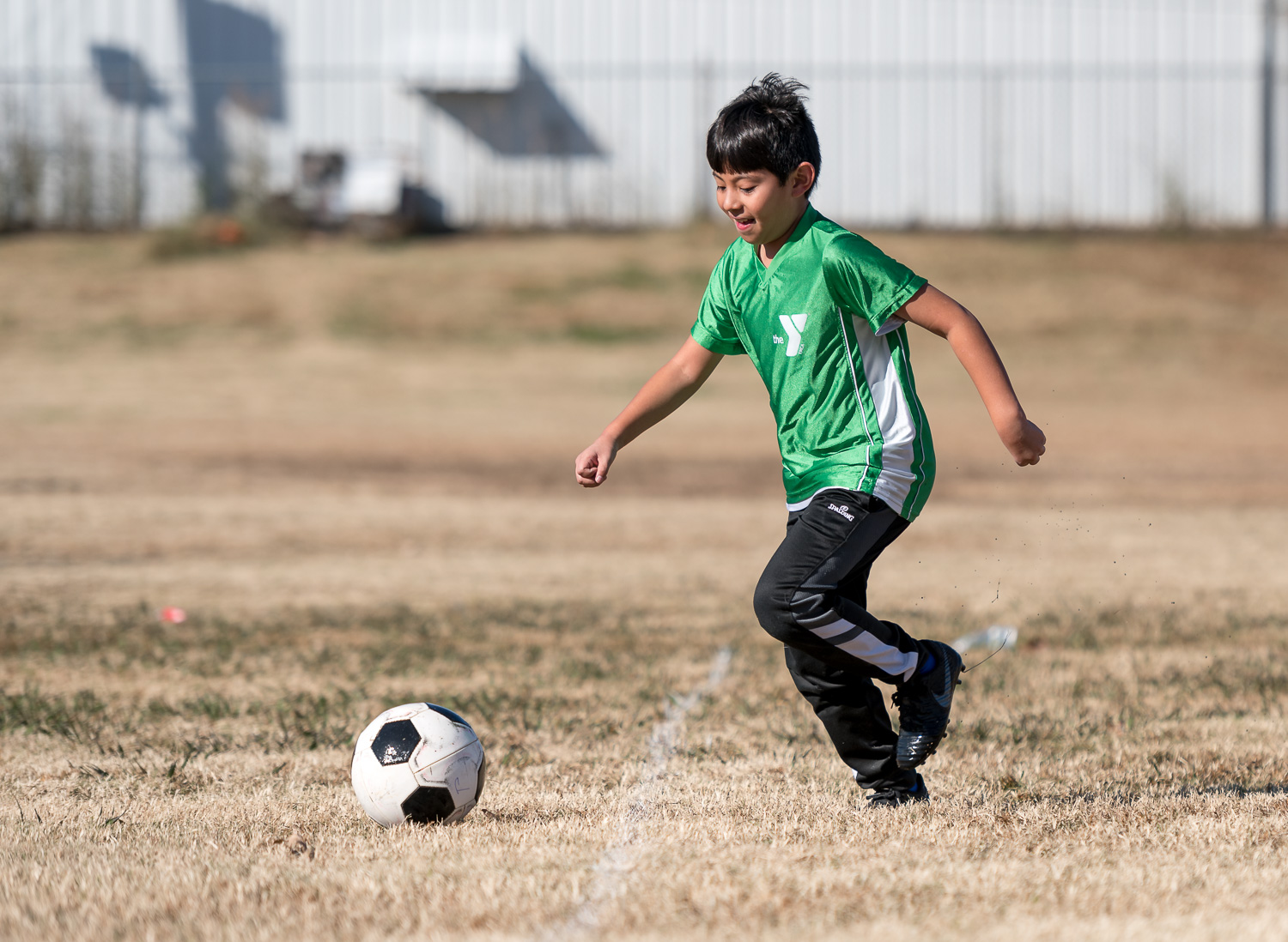 beginner photography tips – a child playing soccer