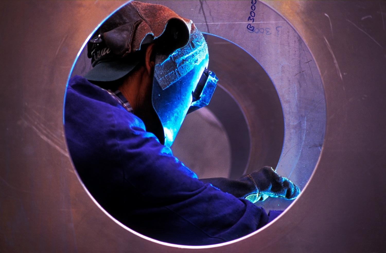welder working in a round frame