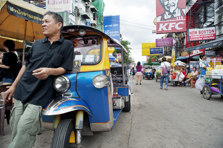 Tuktuk driver in Bangkok for merging