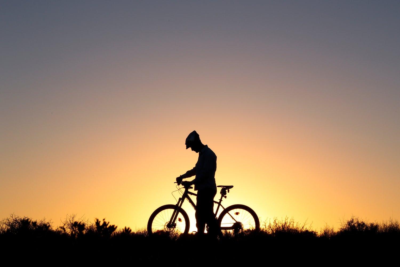 silhouette of a biker