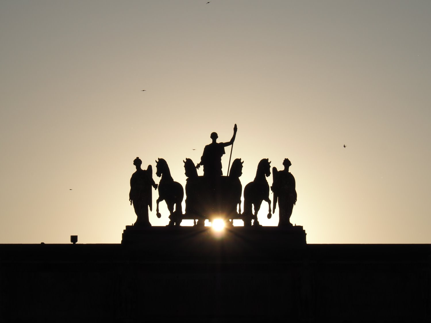 silhouette photography statue
