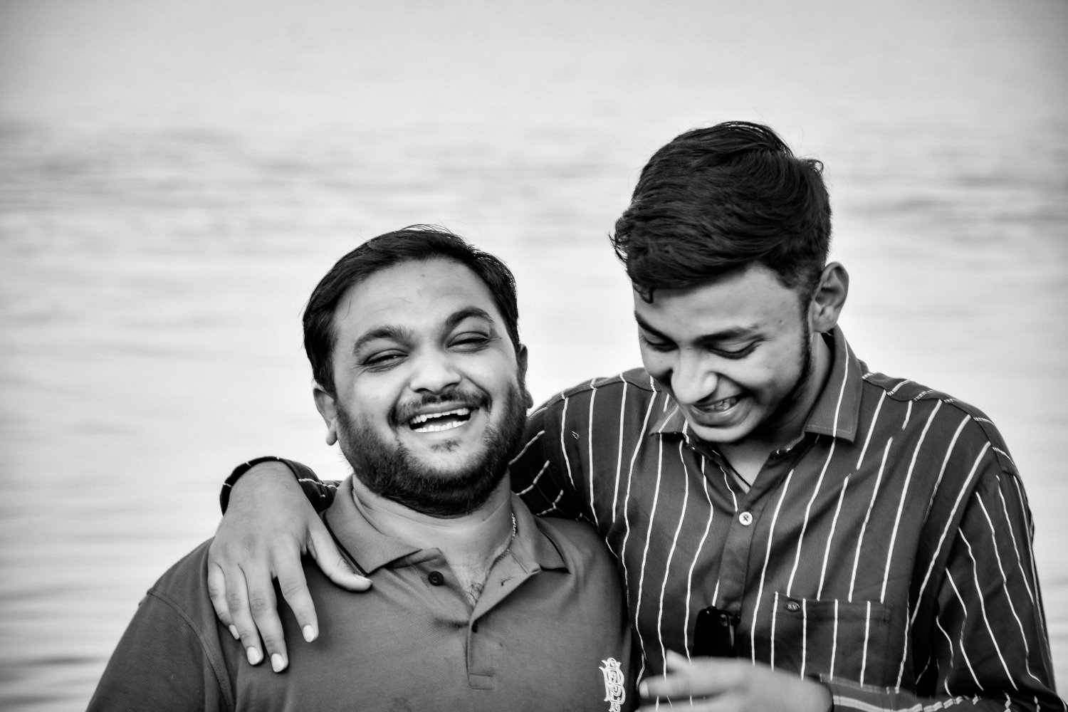 two friends standing and laughing