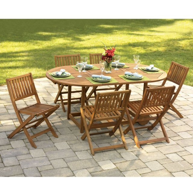the gateleg patio table and stowable chairs - hammacher schlemmer