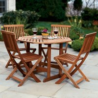 The Trestle Patio Table and Stow Away Chairs - Hammacher ...