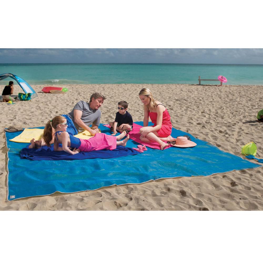 The FourPerson Sandless Beach Mat  Hammacher Schlemmer