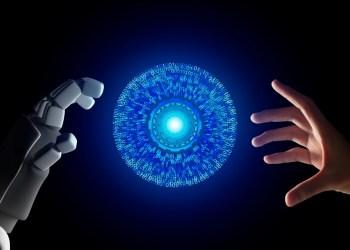 masa depan ai, teknologi digital, wa web, ib bri, bisnis masa depan teknologi ai - human hand and robot hand with hud circle interface and binary number code on black screen background t20 AVANJV - Masa Depan dan Dampak Teknologi AI Bagi Kehidupan